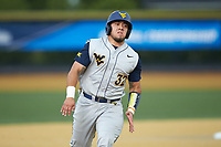 Ivan Gonzalez (32) of the West Virginia Mountaineers hustles towards third base against the Wake Forest Demon Deacons in Game Six of the Winston-Salem Regional in the 2017 College World Series at David F. Couch Ballpark on June 4, 2017 in Winston-Salem, North Carolina. The Demon Deacons defeated the Mountaineers 12-8. (Brian Westerholt/Four Seam Images)