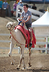Sean Cary competes in a media day camel race at the International Camel Races in Virginia City, Nev., on Friday afternoon, Sept. 7, 2012. The 53rd annual event continues Saturday at 1 p.m. and at noon on Sunday..Photo by Cathleen Allison