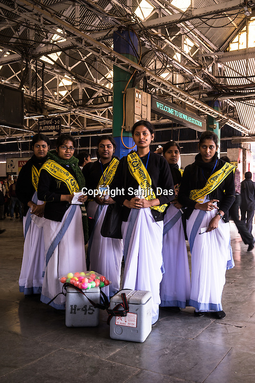 Nursing students from the Howrah District Hospital pose for a photograph at the Howrah station in West Bengal, India. These students vaccinate the transiting children at the train station which is a major inter-city Railway station for travellers travelling from Calcutta with their children.