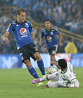BOGOTA - COLOMBIA -07 -02-2015: Federico Insua (Izq) jugador de Millonarios disputa el balón con Jhon Cano (Der) jugador de Patriotas FC, durante partido entre Millonarios y Patriotas FC por la fecha 2 de la Liga Aguila I-2015, jugado en el estadio Nemesio Camacho El Campin de la ciudad de Bogota. / Federico Insua (L) player of Millonarios vies for the ball with Jhon Cano (R) player of Patriotas FC, during a match between Millonarios and Patriotas FC for the  date 1 of the Liga Aguila I-2015 at the Nemesio Camacho El Campin Stadium in Bogota city, Photo: VizzorImage / Gabriel Aponte / Staff.
