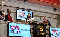 U.S. women national team midfielder Carli Lloyd poses for a photo with the gavel during the centennial celebration of U. S. Soccer at the New York Stock Exchange in New York, NY, on April 02, 2013.