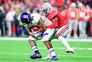 Indianapolis, IN - DEC 1, 2018: Northwestern Wildcats wide receiver Cameron Green (84) is tackled by Ohio State Buckeyes safety Jordan Fuller (4) during second half action of the Big Ten Championship game between Northwestern and Ohio State at Lucas Oil Stadium in Indianapolis, IN. Ohio State defeated Northwestern 45-24. (Photo by Phillip Peters/Media Images International)