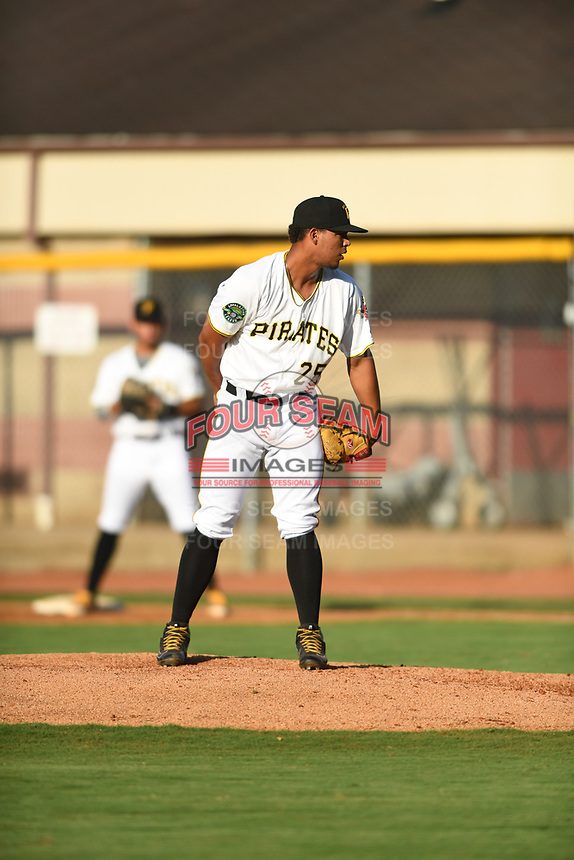Bristol Pirates relief pitcher Luis Arrieta (25) looks in for the sign against the Pulaski Yankees at Boyce Cox Field on July 8, 2019 in Bristol, Virginia. The Yankees defeated the Pirates 5-0. (Tracy Proffitt/Four Seam Images)