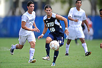 10 September 2011:  FIU's Lucas Di Croce (10) passes the ball in second half as the FIU Golden Panthers defeated the Stetson University Hatters, 3-2 in the second overtime period, at University Park Stadium in Miami, Florida.