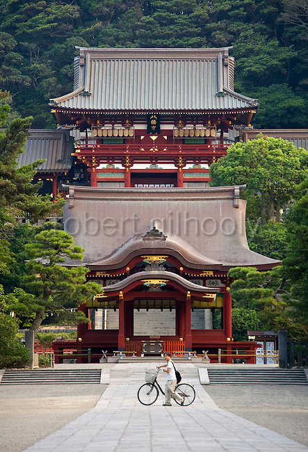 A man passes across the shrine grounds during the annual Reitaisai Grand Festival at Tsurugaoka Hachimangu Shrine in Kamakura, Japan on  14 Sept. 2012.  Sept 14 marks the first day of the 3-day Reitaisai festival, which starts early in the morning when shrine priests and officials perform a purification ritual in the ocean during a rite known as hamaorisai and limaxes with a display of yabusame horseback archery. Photographer: Robert Gilhooly