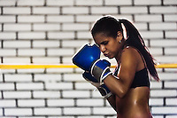 Geraldin Hamann, a young Colombian boxer, practices defense while training in the boxing gym in Cali, Colombia, 26 June 2013. During the recent years, Kina Malpartida, a Peruvian female professional boxer, has won the World Championship title several times and so she has become a sporting idol and an inspiration for a generation of young girls throughout Latin America. Working out hard in poorly equipped gyms, they dream of becoming a boxing star. The Cauca Valley and the Caribbean coast are believed to be a home of the most talented female boxers in Colombia.