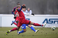 Mauro Zarate of QPR goes for goal as Danny Gabbidon of Chicago Fire closes in