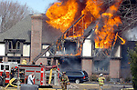 East Hartford firefighters battle a 2nd alarm house fire at 296 Maple in East Hartford, Ct. on Friday March 30, 2007. (Leslloyd F. Alleyne Jr./Photo)