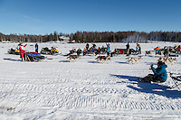 Lisbet Norris runs on Long Lake past spectarors having a picnic during the Restart of the 2016 Iditarod in Willow, Alaska.  March 06, 2016.
