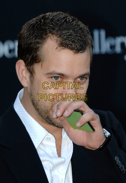 JOSHUA JACKSON.At the Serpentine Gallery Summer Party sponsored by Swarovski, Hyde Park, London, England, June 11th 2007. portrait headshot hand wiping nose over mouth face.CAP/PL.©Phil Loftus/Capital Pictures