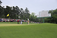 Tiger Woods (USA) Tony Finau (USA) and Francesco Molinari (ITA) on the 18th green during the final round at the The Masters , Augusta National, Augusta, Georgia, USA. 14/04/2019.<br /> Picture Fran Caffrey / Golffile.ie<br /> <br /> All photo usage must carry mandatory copyright credit (© Golffile | Fran Caffrey)