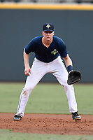 First baseman Dan Rizzie (5) of the Columbia Fireflies plays defense in a game against the Charleston RiverDogs on Monday, August 7, 2017, at Spirit Communications Park in Columbia, South Carolina. Columbia won, 6-4. (Tom Priddy/Four Seam Images)