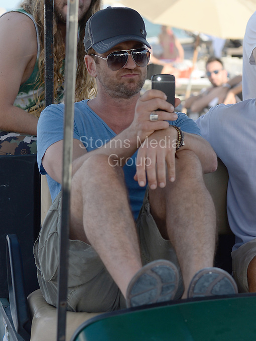 SMG_Gerard Butler_FLXX_Beach Golf Cart_120613_01.JPG<br /> <br /> MIAMI BEACH, FL - DECEMBER 06: Actor Gerard Butler enjoys a day at the beach and is so lazy he needs a golf cart to be driven 50 years back to his hotel and he is so impressed about his VIP treatment he has to film it on his Iphone on December 6, 2013 in Miami, Florida.  (Photo By Storms Media Group) <br /> <br /> People:  Gerard Butler<br /> <br /> Transmission Ref:  FLXX<br /> <br /> Must call if interested<br /> Michael Storms<br /> Storms Media Group Inc.<br /> 305-632-3400 - Cell<br /> 305-513-5783 - Fax<br /> MikeStorm@aol.com<br /> www.StormsMediaGroup.com