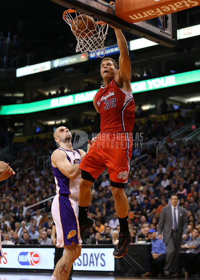 Jan. 24, 2013; Phoenix, AZ, USA: Los Angeles Clippers forward Blake Griffin (32) dunks the ball above Phoenix Suns center Marcin Gortat in the first half at the US Airways Center. Mandatory Credit: Mark J. Rebilas-USA TODAY Sports