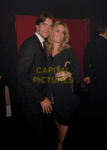 "CHRIS TIKKIA & GUEST.""The Da Vinci Code"" party at the 59th International Cannes Film Festival, Cannes, France..May 17th, 2006.Ref: FIN.half length black suit.www.capitalpictures.com.sales@capitalpictures.com.©Steve Finn/Capital Pictures"
