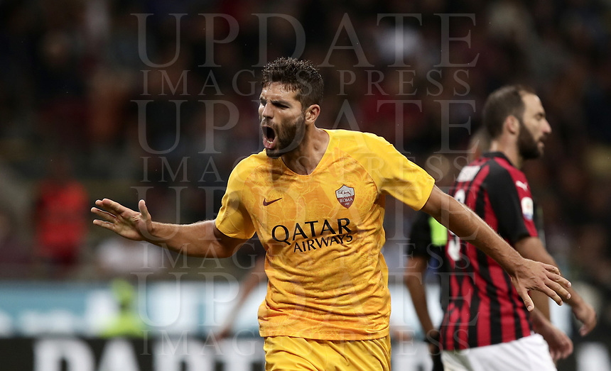 Calcio, Serie A: AC Milan - AS Roma, Milano stadio Giuseppe Meazza (San Siro) 31 agosto 2018. <br /> AS Roma's Federico Fazio celebrates after scoring during the Italian Serie A football match between Milan and Roma at Giuseppe Meazza stadium, August 31, 2018. <br /> UPDATE IMAGES PRESS/Isabella Bonotto