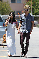 Happy family: Vanessa Hudgens seen going to church with boyfriend Austin Butler and his_mom in Studio City on Sunday. Vanessa wore a tassled maxi dress and a brown suede bag. Los Angeles, California on 24.06.2012. NOTICE: Vanessa is bioting her finger nails..Credit: Correa/face to face.. /MediaPunch Inc. ***FOR USA ONLY*** ***Online Only for USA Weekly Print Magazines*** *NORTEPHOTO*<br />