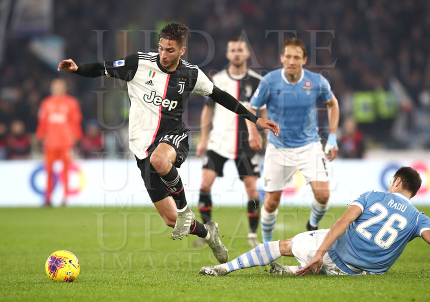 Football, Serie A: S.S. Lazio - Juventus Olympic stadium, Rome, December 7, 2019. <br /> Juventus' Rodrigo Bentancur (l) in action with Lazio's Stefan Radu (l) during the Italian Serie A football match between S.S. Lazio and Juventus at Rome's Olympic stadium, Rome on December 7, 2019.<br /> UPDATE IMAGES PRESS/Isabella Bonotto