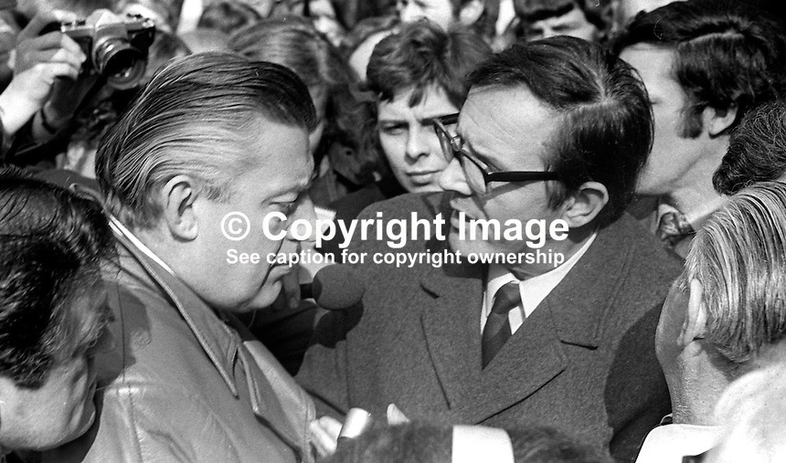 Rev Ian Paisley, leader, Democratic Unionist Party, and Merlyn Rees, Secretary of State for N Ireland, in discussion after meeting up in Royal Avenue, Belfast, N Ireland, following a Provisional IRA bomb that severely damaged the British Army's HQ in the city centre. 197403290179<br />