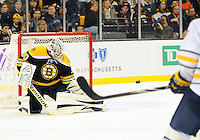 Boston Bruins goalie Tim Thomas #30 keeps his eye on the puck and makes a save during second period game action Saturday at TD Garden...GATEHOUSE NEWS SERVICE PHOTO BY ERIC CANHA