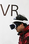 A visitor tests the virtual reality headset PlayStation VR during the Anime Japan 2016 in Tokyo Big Sight on March 26, 2016, Tokyo, Japan. Anime Japan 2016 is the world's biggest exhibition promoting all aspects of the Anime industry to local and foreign fans and business investors. The exhibition is held over three days until March 27 and is expected to attract some 120,000 visitors, many wearing cosplay. (Photo by Rodrigo Reyes Marin/AFLO)