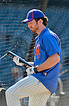 "24 July 2012: New York Mets first baseman Ike Davis plays ""air bat guitar"" while he awaits his turn in the batting cage prior to a game against the Washington Nationals at Citi Field in Flushing, NY. The Nationals defeated the Mets 5-2 to take the second game of their 3-game series. Mandatory Credit: Ed Wolfstein Photo"
