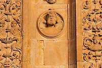 Salamanca (Wednesday, October 24, 2012) Convent of San Esteban. Detail of the facade.  The church facade, complete with it's 'dustcover' and fine ornamentation that seems to turn to gold when touched by sunlight, constitutes one of the most complete illustrations of Spanish Renaissance. The beautiful convent cloister combines a Gothic design with Renaissance decorative elements, as is the case with buildings erected throughout the 16th century. Salamanca is a city in northwestern Spain, the capital of the Province of Salamanca in the community of Castile and León. Its Old City was declared a UNESCO World Heritage Site in 1988. With a metropolitan population around 192,000 it is the second most populated urban area in Castile and León, after Valladolid (369,000), and closely followed by Leon (187,000) and Burgos (176,000)...It is the most important university city in Spain and supplies 16% of Spain's market for the teaching of the Spanish language.[1][2] Salamanca attracts thousands of international students,[3] generating a diverse environment...It is situated approximately 200 km (120 mi) west of the Spanish capital Madrid and 80 km (50 mi) east of the Portuguese border. The University of Salamanca, which was founded in 1218, is the oldest university in Spain and the third oldest western university, but the first to be given its status by a Pope (Alexander IV).Photo: joliphotos.com