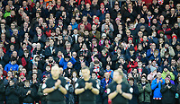 Lincoln City fans during a minutes' applause in memory of Kevin Austin<br /> <br /> Photographer Chris Vaughan/CameraSport<br /> <br /> The Emirates FA Cup Second Round - Lincoln City v Carlisle United - Saturday 1st December 2018 - Sincil Bank - Lincoln<br />  <br /> World Copyright © 2018 CameraSport. All rights reserved. 43 Linden Ave. Countesthorpe. Leicester. England. LE8 5PG - Tel: +44 (0) 116 277 4147 - admin@camerasport.com - www.camerasport.com