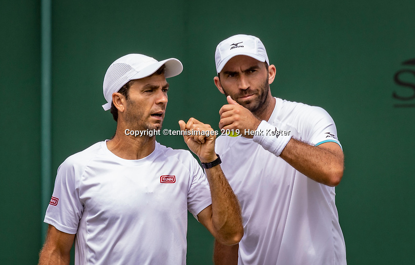 London, England, 5 July, 2019, Tennis,  Wimbledon, Men's doubles: Jean-Julien Rojer (NED) and Horia Tecau  (ROU) (R)<br /> Photo: Henk Koster/tennisimages.com