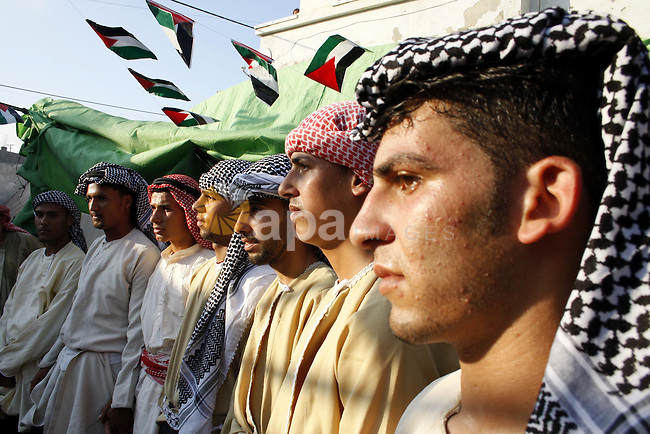 Palestinians dance during a wedding ceremony in Beit Hanoun town in the northern Gaza Strip July 22, 2009. Photo By Ashraf Amra