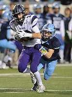 NWA Democrat-Gazette/ANDY SHUPE<br /> Garland Allison (left) of Fayetteville carries the ball after making a catch as Blaze Brothers of Har-Ber reaches to make the tackle Saturday, Dec. 5, 2015, during the first half of the Class 7A state championship game at War Memorial Stadium in Little Rock. Visit nwadg.com/photos to see more photographs from the game.