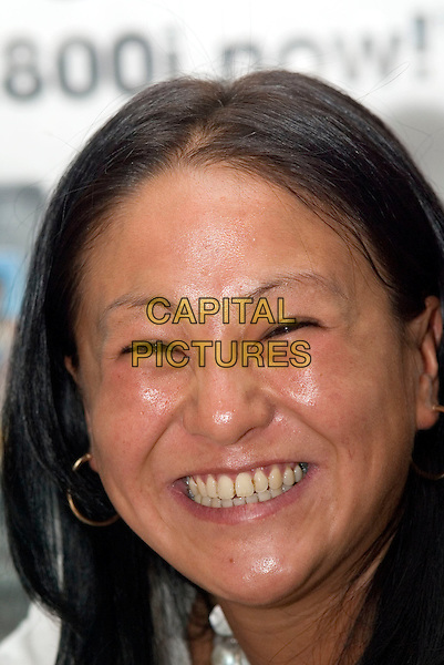LISA HUO.First public appearance after leaving BB at Carphone Wharehouse Market Street, Manchester, UK.  .June 30th, 2006.Ref: AT.Big Brother headshot portrait hoop earrings.www.capitalpictures.com.sales@capitalpictures.com.© Capital Pictures.