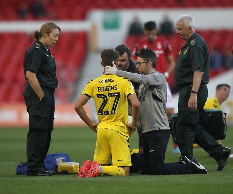 Fleetwood Town's Harrison Biggins receives attention<br /> <br /> Photographer Mick Walker/CameraSport<br /> <br /> The Carabao Cup First Round - Nottingham Forest v Fleetwood Town - Tuesday 13th August 2019 - The City Ground - Nottingham<br />  <br /> World Copyright © 2019 CameraSport. All rights reserved. 43 Linden Ave. Countesthorpe. Leicester. England. LE8 5PG - Tel: +44 (0) 116 277 4147 - admin@camerasport.com - www.camerasport.com