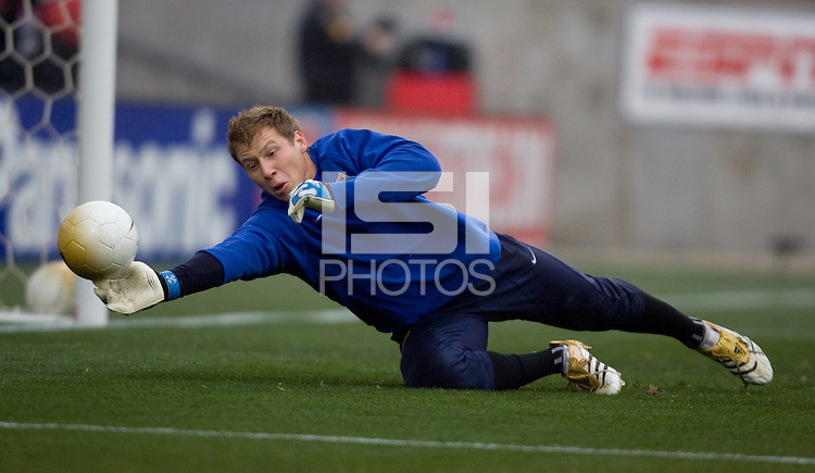 Starting goalkeeper Brad Guzan warms up for the match at Pizza Hut Park in Frisco, Texas, Sunday, Feb. 19, 2005.  USA won 4-0.