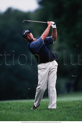 RETIEF GOOSEN (RSA) plays out of the light rough Volvo PGA Championship at Wentworth,990531.Photo:Glyn Kirk/Action Plus...1999.golf.golfer golfers