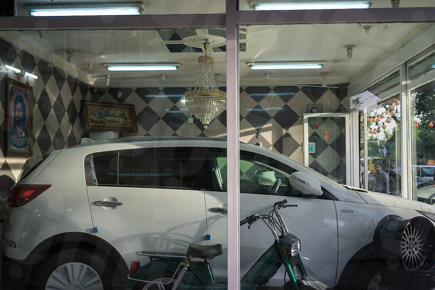 June 12, 2014 - Tehran, Iran. A car is sold in a small show room of the capital. Due to the international sanctions, importation of foreign cars is expensive and many Iranians opt to buy locally produced cars. © Thomas Cristofoletti / Ruom