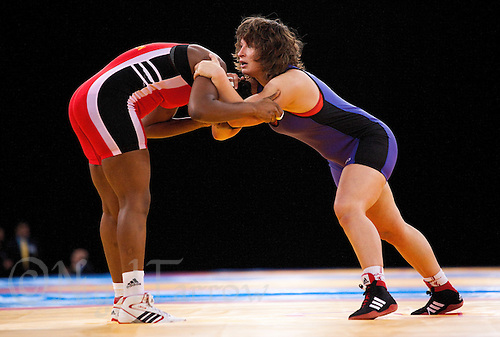 11 DEC 2011 - LONDON, GBR - Zlateva Stanka (BUL) (in blue) attempts to overpower Annabel Laure Ali (CMR) (in red) during their 72kg category semi final bout at the London International Wrestling Invitational and 2012 Olympic Games test event  at the ExCel Exhibition Centre in London, Great Britain .(PHOTO (C) NIGEL FARROW)