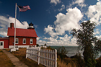 Big puffy clouds dominate the sky over Lake Superior and the Eagle Harbor Lighthouse, Keweenaw County, Michigan