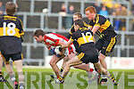 Crokes swarm defence Brian Looney, Johnny Buckley and Colm Cooper swallow up Brendan O'Keeffe Rathmore during the O'Donoghue Cup final in Fitzgerald Stadium on Sunday