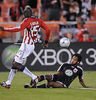 DC United defender Lawson Jakovic (15) slides to defend the play against Chivas USA defender Yamith Cuesta (45).  Chivas USA defeated DC United 2-0  at RFK Stadium, Saturday October 3, 2009.