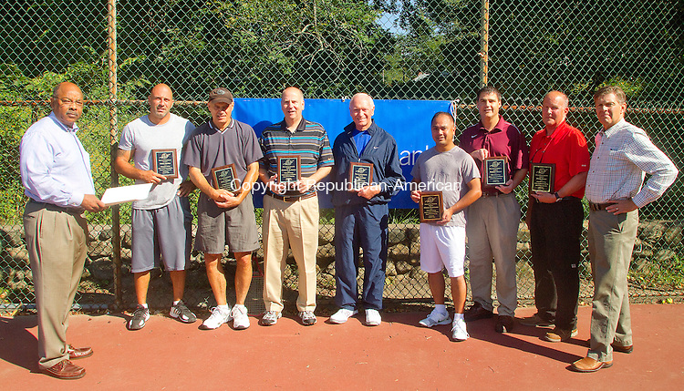 WATERBURY, CT.- 07 SEPTEMBER 2013 - 090713JW01 - Administration Aide to the Mayor of Waterbury Monroe Webster poses for a photo with the 2013 J. Francis Smith - Pearl Street Tennis Hall of Fame member inductees Chris McKee, John McKee, David Labriola, Fred Ludke, Marcel Nicolasora, Robert Mezzo, and David Green as Webster Bank Senior Vice President of Public Affairs Bob Guenther looks on Saturday morning at Fulton Park.<br /> Jonathan Wilcox Republican American