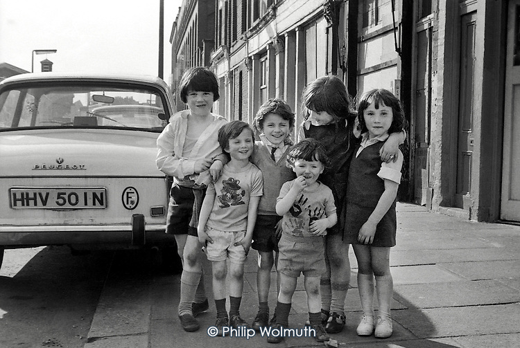 1975: children outside boarded-up shops, since demolished, in Kensal Road, North Kensington.