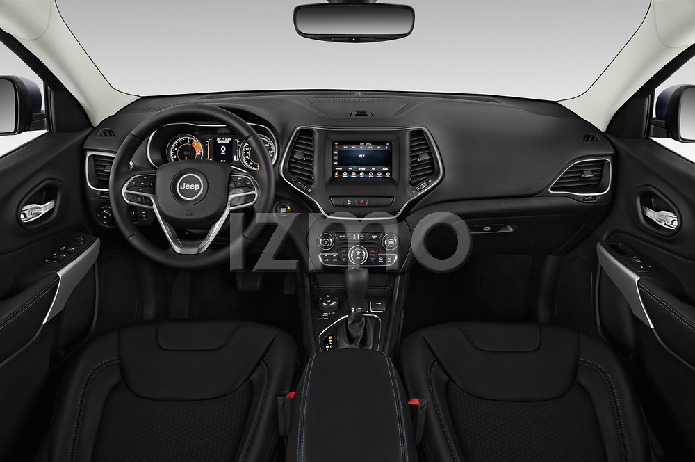 Stock photo of straight dashboard view of a 2019 Jeep Cherokee Latitude Plus 4X4 5 Door SUV