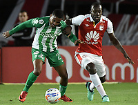 BOGOTÁ - COLOMBIA, 28-07-2018: Baldomero Perlaza (Der.) jugador de Santa Fe disputa el balón con Jeison Steven Lucumi (Izq.) jugador del Nacional durante el encuentro entre Independiente Santa Fe y Atlético Nacional por la fecha 2 de la Liga Águila II 2018 jugado en el estadio Nemesio Camacho El Campin de la ciudad de Bogotá. / Baldomero Perlaza (R) player of Santa Fe struggles for the ball with Jeison Steven Lucumi (L) player of Nacional during match between Independiente Santa Fe and Atletico Nacional for the date 2 of the Aguila League II 2018 played at the Nemesio Camacho El Campin Stadium in Bogota city. Photo: VizzorImage/ Gabriel Aponte / Staff