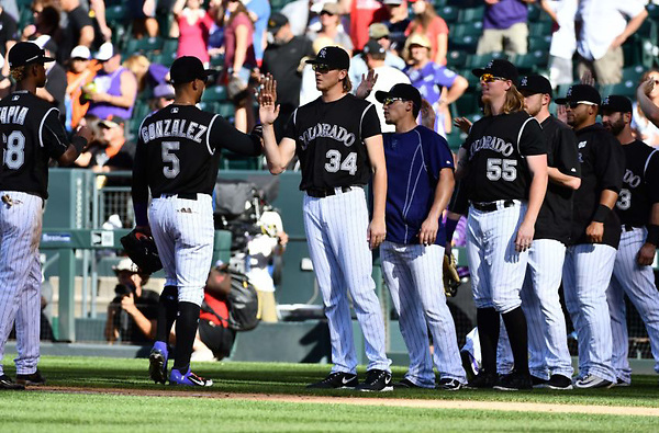 Sep 5, 2016; Denver, CO, USA; Members of the Colorado Rockies celebrate a win over the San Francisco Giants at Coors Field. The Rockies defeated the Giants 6-0. Mandatory Credit: Ron Chenoy-USA TODAY Sports