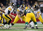 Pittsburgh Steelers offensive lineman Doug Legursky (64) and Chris Kemoeatu (68) double team Green Bay Packers defensive lineman B.J. Raji (90) during Super Bowl XLV on Sunday, February 6, 2011, in Arlingto, Texaas. The Packers won 31-25. (AP Photo/David Stluka)