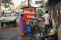 "S?dasien Asien Indien IND Tirupur .Frauen warten vor Coca Cola Werbung auf Wasser in T-shirt town Tirupur , Wasserknappheit durch fallende Grundwasserspiegel ausbleibenden Monsun und Wasserverbrauch durch hunderte F?rbereien im Textilstandort Tirupur - Wassermangel Trinkwasser Textilindustrie Globalisierung Umwelt saubere Kleidung T-shirt Wasserkrug Wasserpot Coca-Cola CocaCola Werbeschild Privatisierung Kapitalisierung von Resourcen Wasser Wasserknappheit Durst durstig Rohstoffe Wassergesch?ft Getr?nke Industrie Lebensmittel Lebensmittelkonzerne multinationale Konzerne Vermarktung kostbares Gut Wasser Grundwasser xagndaz | .South Asia India Tamil Nadu Tirupur .people wait in front of Coke Ad for water supply with clean fresh water in textile city Tirupur where is a permanent water shortage due to failing monsoon rain and falling groundwater levels by high consumption of hundreds of textile dying units - environment waste of water shortag thirst resources drinking water textile industry globalization clean clothes fetch  pots plastic color coloured coca cola advertisement billboard multinationals .agua thirst thirsty watershortage privatization CocaCola drop .| [ copyright (c) Joerg Boethling / agenda , Veroeffentlichung nur gegen Honorar und Belegexemplar an / publication only with royalties and copy to:  agenda PG   Rothestr. 66   Germany D-22765 Hamburg   ph. ++49 40 391 907 14   e-mail: boethling@agenda-fototext.de   www.agenda-fototext.de   Bank: Hamburger Sparkasse  BLZ 200 505 50  Kto. 1281 120 178   IBAN: DE96 2005 0550 1281 1201 78   BIC: ""HASPDEHH"" ,  WEITERE MOTIVE ZU DIESEM THEMA SIND VORHANDEN!! MORE PICTURES ON THIS SUBJECT AVAILABLE!! INDIA PHOTO ARCHIVE: http://www.visualindia.net ] [#0,26,121#]"