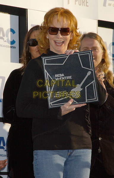 REBA McENTIRE.Music City Walk of Fame Class of 2006 Induction held at the Hall of Fame Park, Nashville, Tennessee , USA..November 5th, 2006.Ref: ADM/LF.half length plaque sunglasses shades.www.capitalpictures.com.sales@capitalpictures.com.©Laura Farr/AdMedia/Capital Pictures.