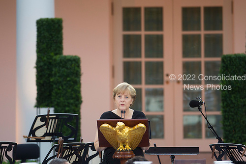 """Angela Merkel, Germany's chancellor, speaks during a State Visit with United States President Barack Obama in the Rose Garden of the White House in Washington, D.C., U.S., on Tuesday, June 7, 2011. Obama said he and Merkel agreed that the debt crisis in Europe """"cannot be allowed to put the global economic recovery at risk."""" .Credit: Andrew Harrer / Pool via CNP"""
