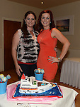 Fiona Curley pictured with her sister Liz Burke who designed the cake for her going away party in the Glenside hotel. Photo:Colin Bell/pressphotos.ie